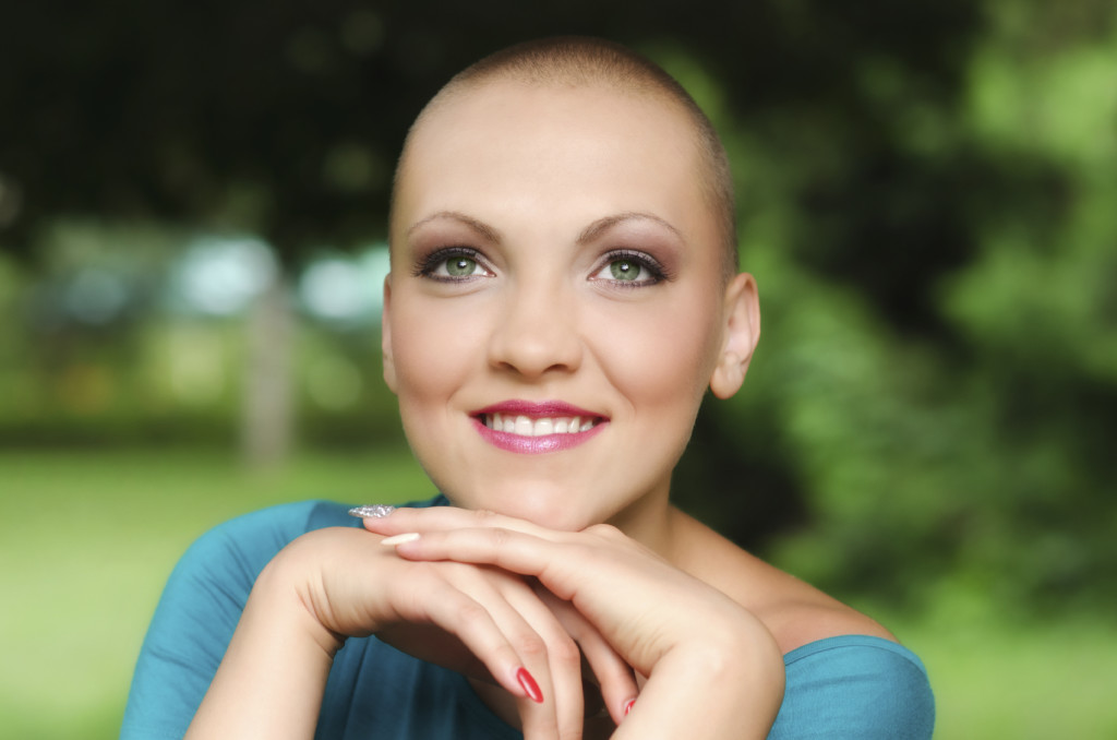 Happy and young cancer survivor after successful chemotherapy.