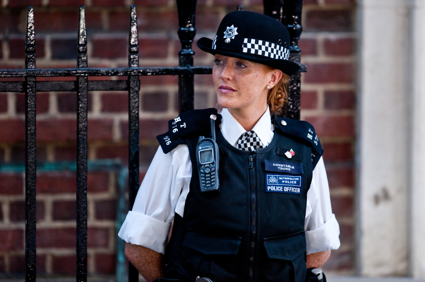 London, UK - July 22 2013: a woman police officer guards the entrance of St. Mary's Hospital in London on July 22, 2013 on the day the Royal Baby is born.