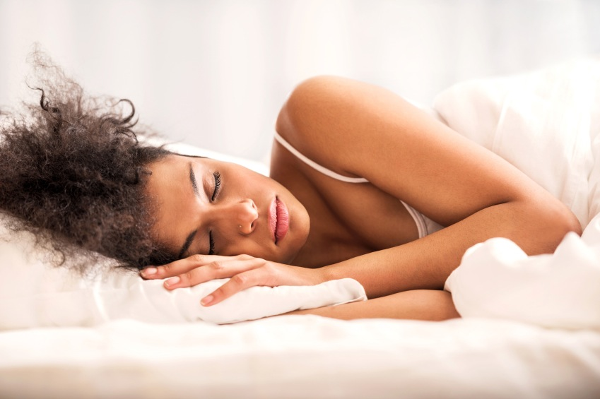 Young African-American woman sleeping.