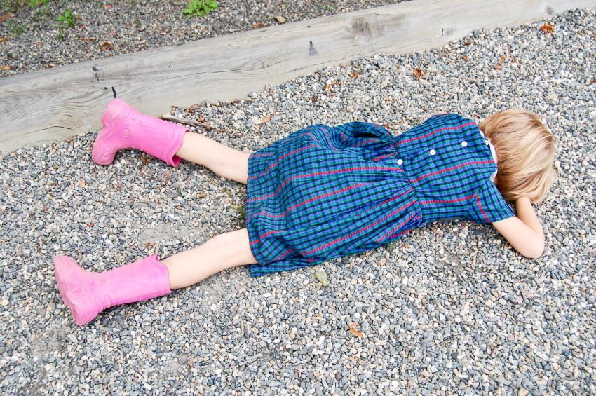 Sad girl lying on the ground